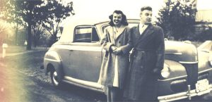 vintage photo of couple in front of a car