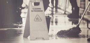 mopping the floor, cleaning in progress sign