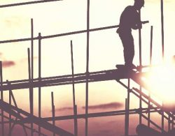 General Liability Insurance - construction workers on building frame
