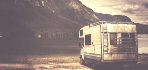 RV Insurance - vintage photo of rv by the lake