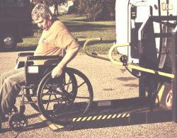 Disability Insurance - man in wheelchair using a lift