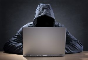 cyber liability insurance - hacker at computer