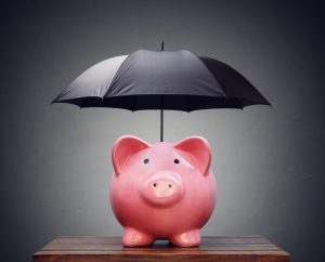 piggy bank with black umbrella over it