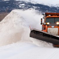 snow plow insurance - snow plow clearing after blizzard