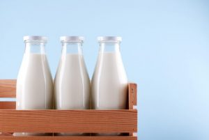 current milk prices - milk bottles in a crate