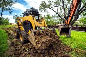 landscaping insurance - small bulldozer moving land