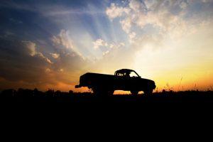pickup truck insurance - pickup truck silhouette against a sunset
