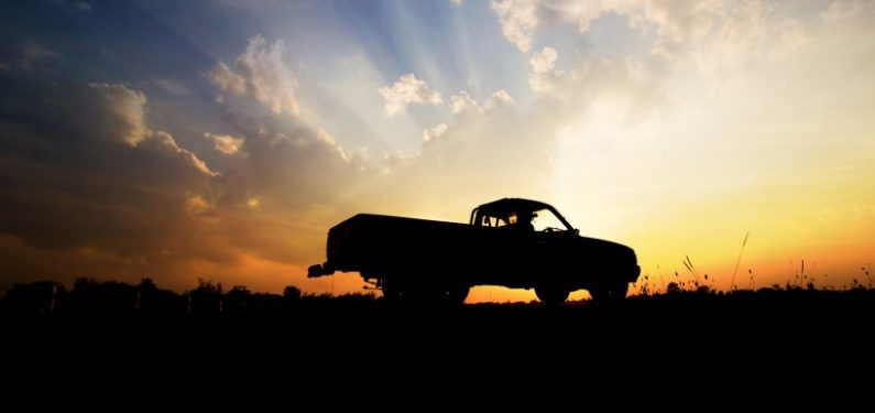 pickup truck insurance - pickup truck silhouette against a sunset