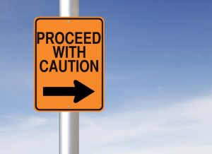 proceed with caution sign