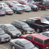 parking lot with different types of vehicles