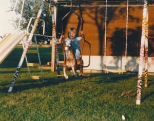 child on a swingset