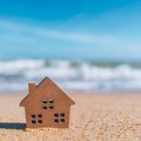 little wooden house on the sand