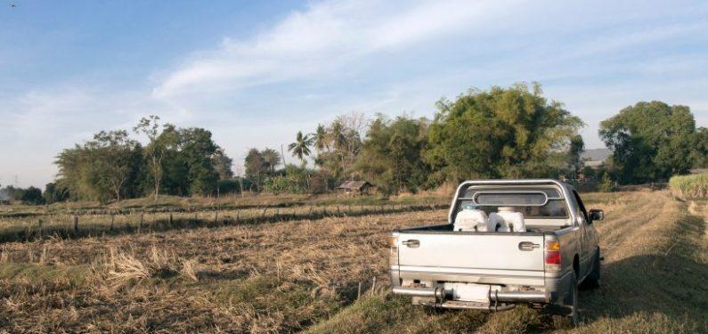 farm truck driving through a field