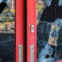 business with broken glass doors