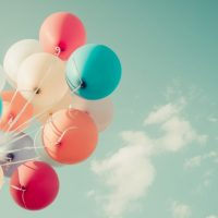 bunch of balloons against a sky background